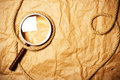 Magnifying glass and rope Royalty Free Stock Images