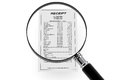 Magnifying glass & Shopping Receipt Stock Photography