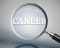 Magnifying glass showing career word in white on grey background Stock Images