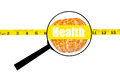 Magnifying glass showing orange health word and measure waist on white background Royalty Free Stock Images