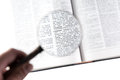 Magnifying glass word computer dictionary Stock Photography