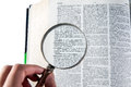 Magnifying glass word successful dictionary Stock Photography