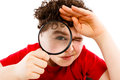 Magnifying glass young boy holding isolated on white background Royalty Free Stock Image