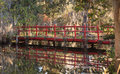 At magnolia plantation and gardens in charleston south carolina the famous red bridge is reflected in schoolhouse lake and Royalty Free Stock Image