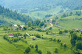 Magura village landscape with scattered houses at foothills piatra craiului mountains romania Stock Image