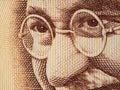 Mahatma gandhi face on indian rupee banknote extreme macro india money closeup Royalty Free Stock Image