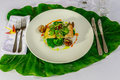 Mahi-mahi fillet and clams with broccoli and fresh herbs Royalty Free Stock Photo