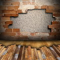 Mahogany floor installing on cracked interior backdrop with wall Royalty Free Stock Photos