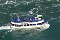 Maid of the mist niagara falls tourboat at usa and canada before it enters Stock Images