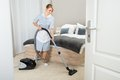 Maid With Vacuum Cleaner In Ho...