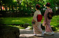 Maiko girls and Japanese garden, Kyoto Japan Royalty Free Stock Photo