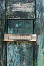 Mail delivery slot on weathered old wooden door on building in Lisbon, Portugal Royalty Free Stock Photography