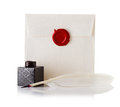 Mail envelope or letter sealed with wax seal stamp and quill pen isolated on white Royalty Free Stock Image