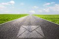 Mail, message symbol on long straight road, highway. Royalty Free Stock Photo