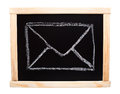 Mail symbol drawn on blackboard with white chalk Royalty Free Stock Images