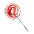 Mail at @ symbol under the magnifier Royalty Free Stock Photos