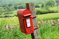 Mailbox in english countryside of cotswolds od hanging on wood Stock Images