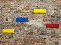Mailbox slots on brick wall background a with four colorful Stock Images