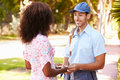 Mailman Delivering Letters To Woman Royalty Free Stock Photo