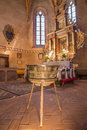 Main altar of gothic evangelical church in stitnik from cent and bronze baptistery by master jana from spisska sob slovakia Stock Photos
