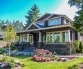 Main entrance of residential house with delicately landscaped front yard Royalty Free Stock Photo