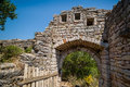Main gate to old ruined fortress in sutomore montenegro and part of a wall of up the hill of resort Stock Images