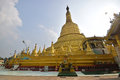 Main giant stupa of Shwemawdaw Pagoda at Bago, Myanmar with sacred praying altar, god statue & offerings