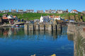 The main harbour boats slipways and village at st abbs berwi pier in berwickshire Royalty Free Stock Photography