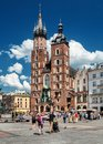 Main market and Basilica of Saint Mary Church of Our Lady Assumed into Heaven also known as Saint Mary`s Church. Cracow in Poland Royalty Free Stock Photo