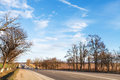 Main road in country district in early spring Royalty Free Stock Photo