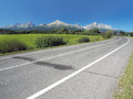 Main road leading to high tatras in summer view of taras vysoké tatry direction from poprad town with panorama of all peaks Royalty Free Stock Image