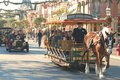 Main street at disneyland california a shot of in with a horse drawn carriage in the foreground and a touring car in the Royalty Free Stock Images