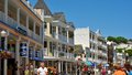 Main street mackinac island mi june on island is thronged with tourists on a bright summer day fort is visible Royalty Free Stock Photo