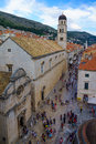 Main street scene dubrovnik croatia june of the stradun or placa the franciscan monastery st saviour church locals and tourists in Royalty Free Stock Images