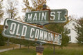 Main Street USA and Old Common Road sign in autumn, western Massachusetts, New England