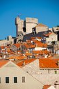 Main tower of dubrovnik fort walls with houses red roofs Stock Image