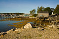 Maine fishing bay buildings and docks in at low tide Royalty Free Stock Images