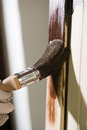 Maintaining of wooden surfaces with fresh protective paint Stock Photo