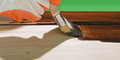 Maintaining of wooden surfaces with fresh protective paint Royalty Free Stock Image