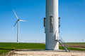 Maintenance access door windmill turbine in bottom part of a tower modern wind providing green energy in Royalty Free Stock Image