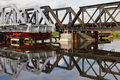 Maintenance of railway bridge, water reflection. Royalty Free Stock Photos