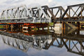 Maintenance of railway bridge, water reflection. Stock Image