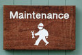 Maintenance sign for showing character man with a spanner symbolizing home improvements diy and professional Stock Photos
