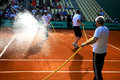 Maintenance of tennis court at Roland Garros 2012 Royalty Free Stock Photos
