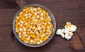 Maize grain dried with popcorn next on wood from above Royalty Free Stock Photo