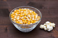 Maize grain dried with popcorn next on wood Royalty Free Stock Photo