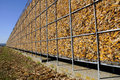 Maize storage sweet corn stored in immense metal framework on farm Stock Image