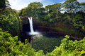 Majesitc Rainbow Falls waterfall in Hilo, Wailuku River State Park, Hawaii Royalty Free Stock Photo