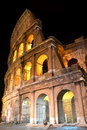 Majestic ancient Colosseum by night in Rome, Italy Royalty Free Stock Photo