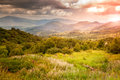 Majestic bright sunset in the mountains Stock Photography